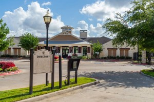 Apartments in Katy, TX - Community Directory Sign, Clubhouse Exterior